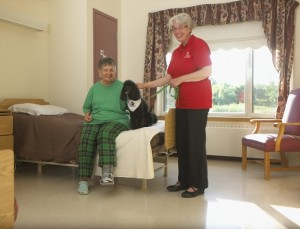 Therapy Dog and handler visiting resident